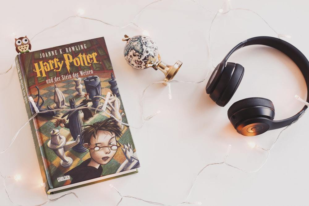 A photo of the Harry Potter book with some essentials