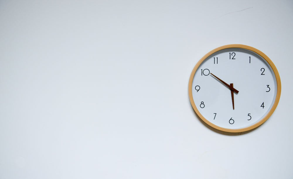 A clock hung on a wall