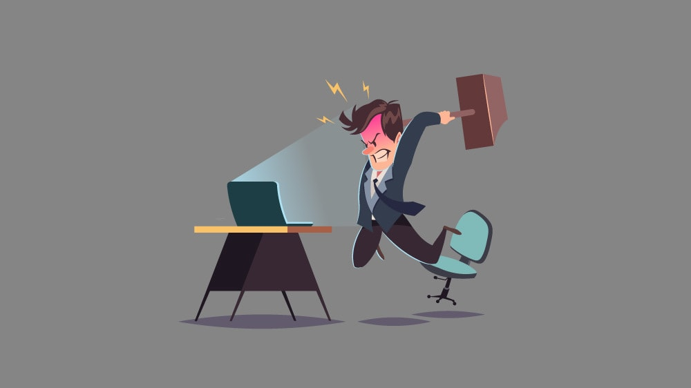 angry business man smashing laptop with a hammer
