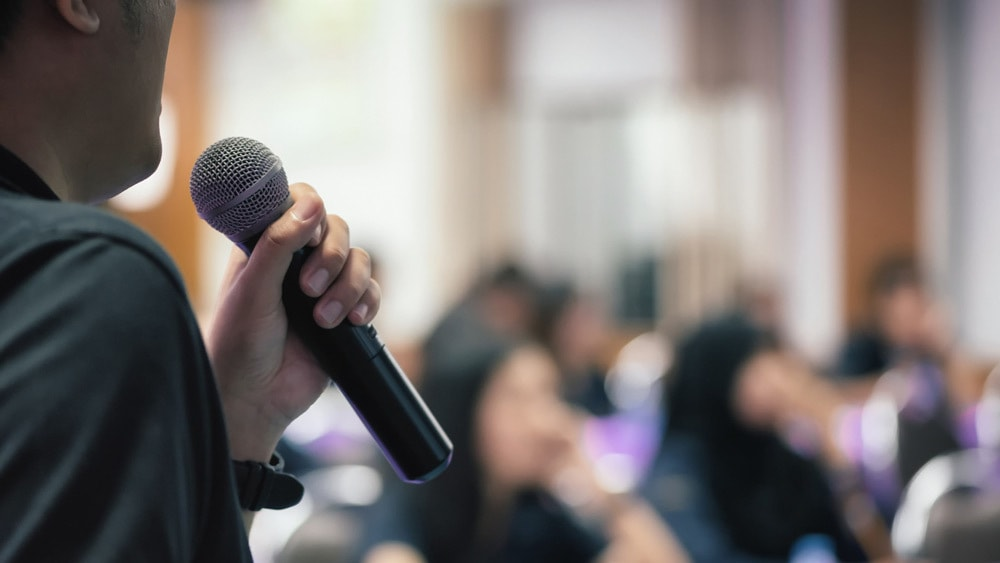 Man giving a speech to a class - an informative lecture - one of the types of public speaking