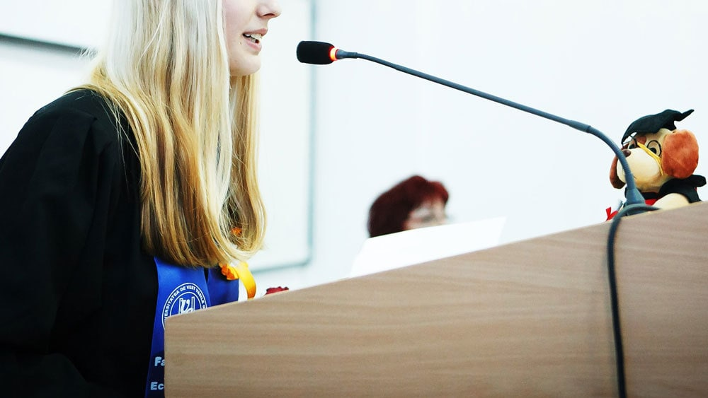 woman giving ceremonial speech in a graduation - a ceremonial speech - one of the types of public speaking