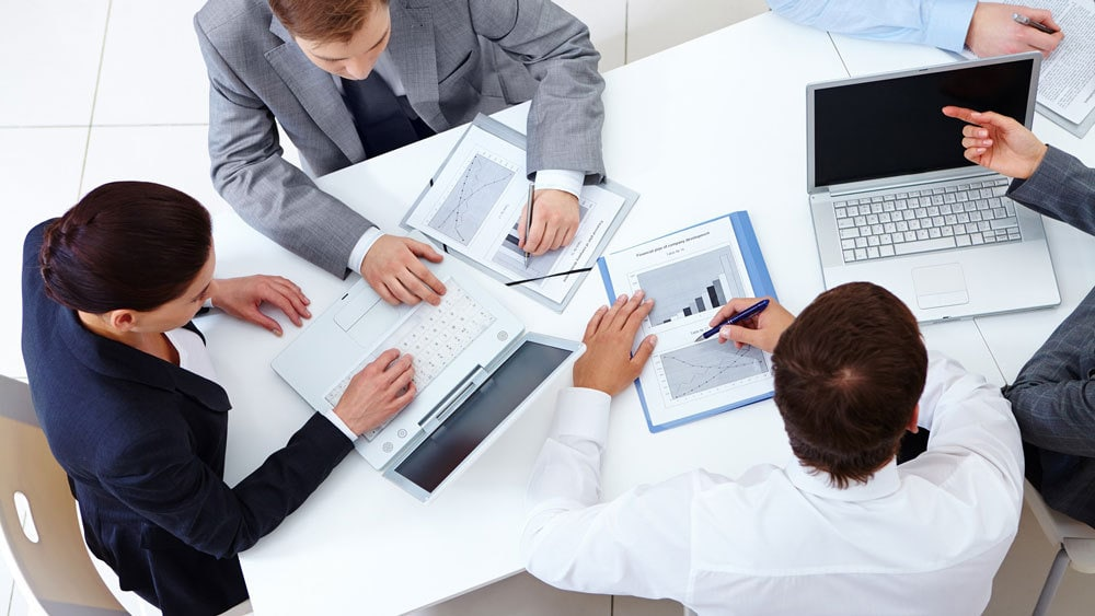 a group of employees (management consultants) working on a project