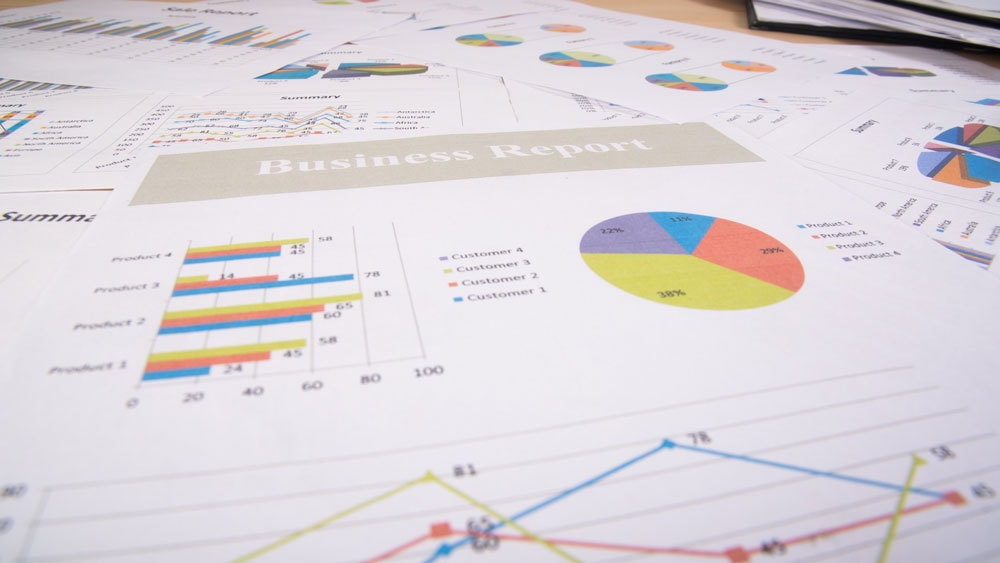 pages from a business report laid out on a table