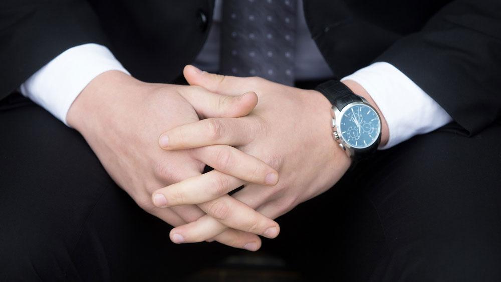 senior executive (ceo) folding his hands
