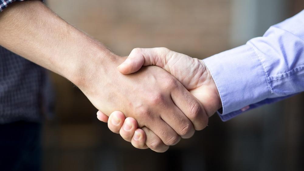 handshake between salesperson and client